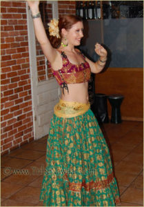 Anna of Tribe Nawaar Dance Company wearing a corseted bodice & sitara skirt