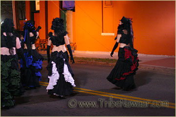 Tribe Nawaar Dance Company wearing bustled skirts, top hats and reversed corseted bodice tops