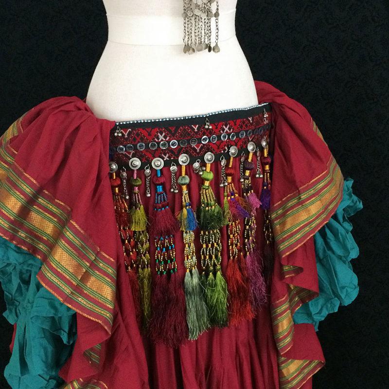 Tribe Nawaar's royal tassel belts in an ATS® bellydance costume